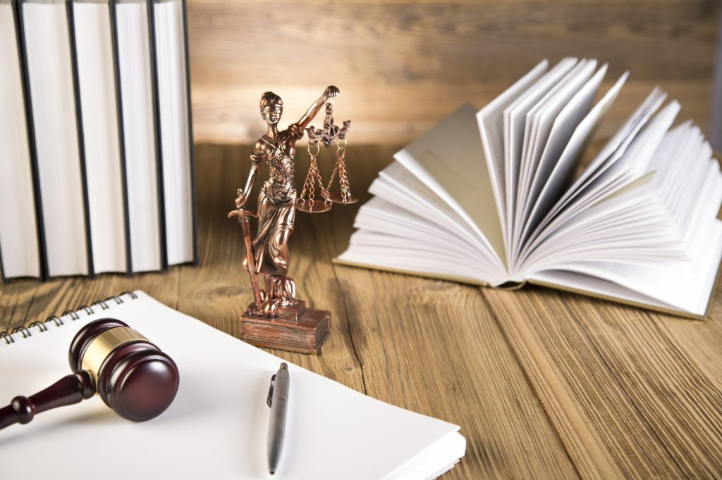 Lady of justice, gavel and books on wooden table